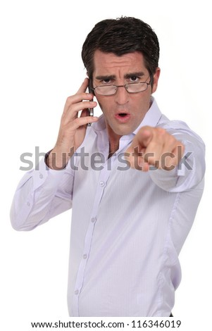 Angry man pointing his finger - stock photo