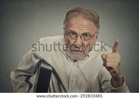 Angry man pointing his finger at somebody - stock photo