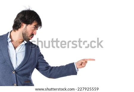 Angry man pointing somebody over isolated white background - stock photo