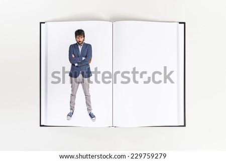 Angry man printed on book - stock photo