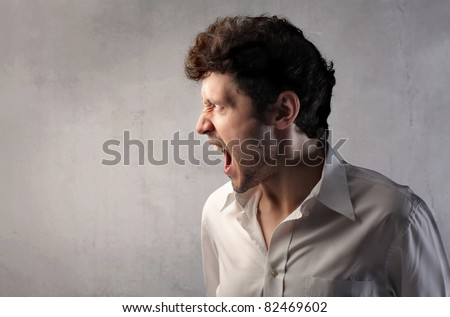 Angry man screaming - stock photo