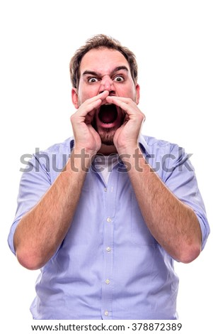 Angry man screaming with hands to his mouth to demonstrate his point - stock photo