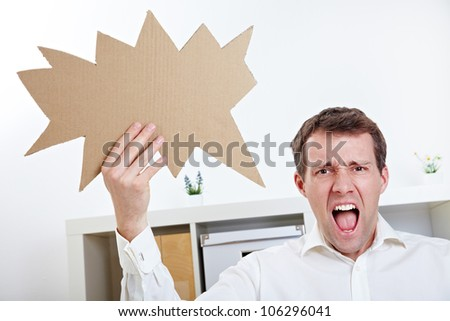 Angry man screaming with speech balloon in his office - stock photo