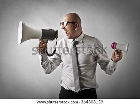 Angry man shouting - stock photo