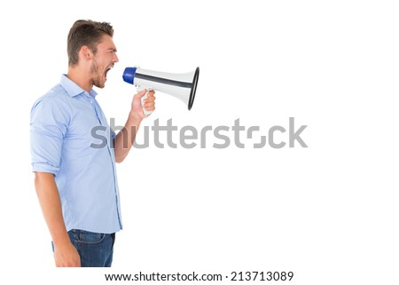 Angry man shouting through megaphone on white background