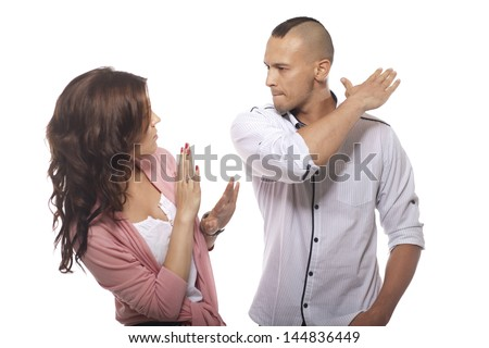 Angry Man Slapping Woman On White Background - stock photo