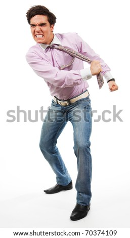 Angry man tear his tie man wearing jeans, shirt and tie, isolated on white - stock photo