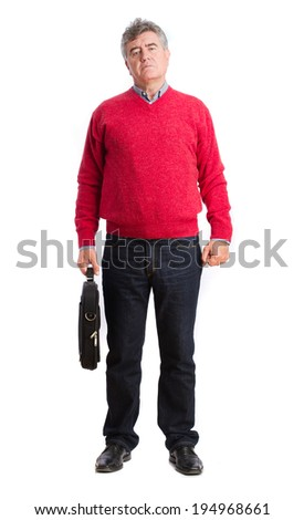 Angry man with a baggage - stock photo
