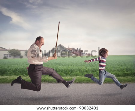 Angry man with a stick running after a child