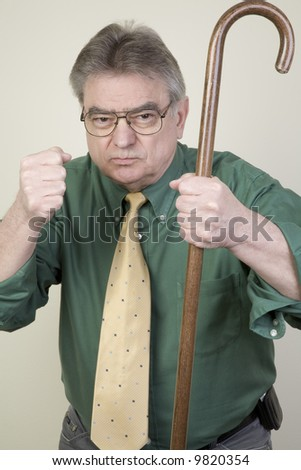 Angry old man with cane