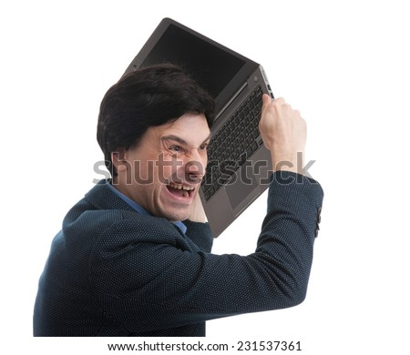 angry man with laptop isolated on a white background - stock photo