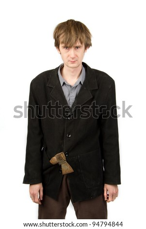 Angry man with rusty axe in the pocket of his suit - stock photo
