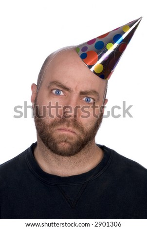 Angry Man with strange expression wearing a party hat isolated over white - stock photo