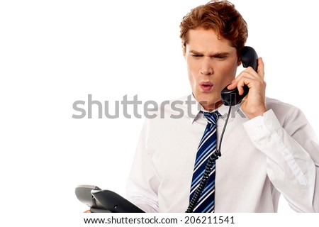 Angry manager screaming in telephone receiver