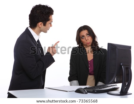 Angry Manager with secretary infront of a computer - stock photo