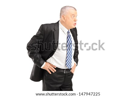 Angry mature businessman in black suit shouting isolated on white background - stock photo