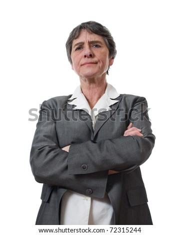 angry mature businesswoman with crossed arms isolated on white background