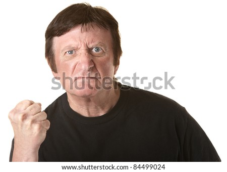Angry mature Caucasian man with clenched fist over white background