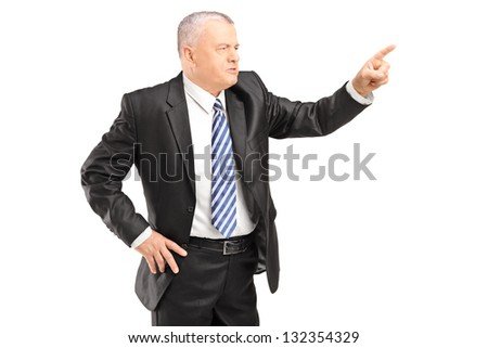 Angry mature man gesturing with finger isolated on white background - stock photo
