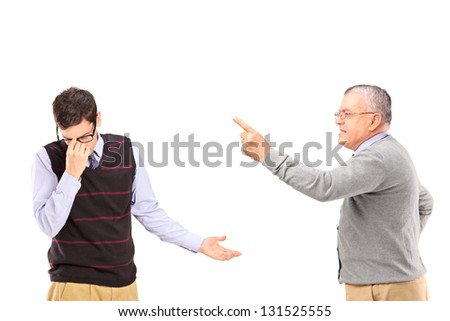 Angry mature man having an argument with a younger upset man isolated on white background - stock photo