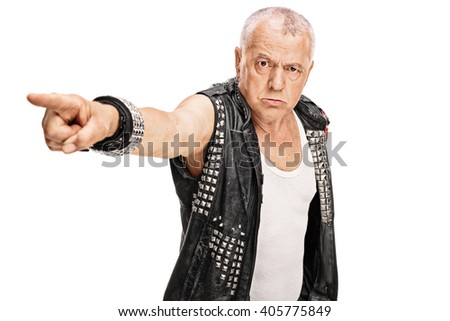 Angry mature punk pointing with his hand towards the camera isolated on white background