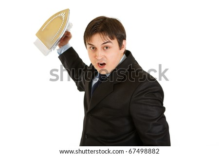 Angry modern businessman menacingly holding iron in hand isolated on white