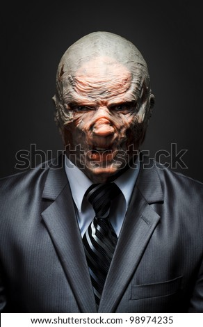 Angry monster in business suit - stock photo