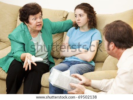 Angry mother complains about her teenage daughter in family therapy. - stock photo
