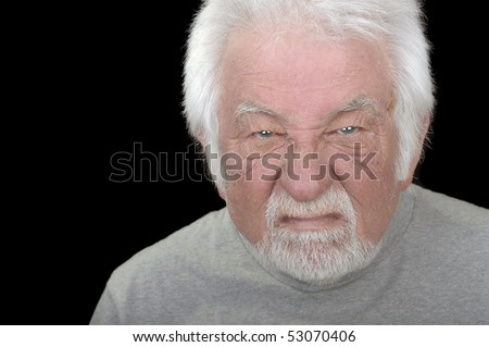 Angry old man on black
