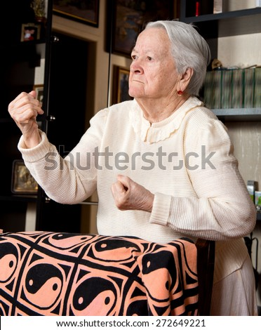 stock photo angry old woman making fists at home 272649221 angry old woman stock images, royalty free images & vectors