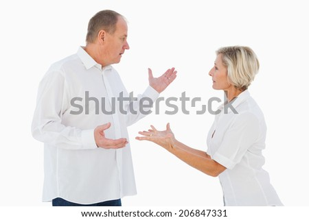 Angry older couple arguing with each other on white background - stock photo