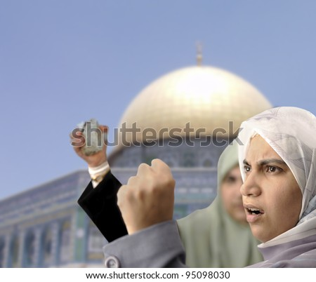 Angry Palestine women fighting with rocks in hands - stock photo