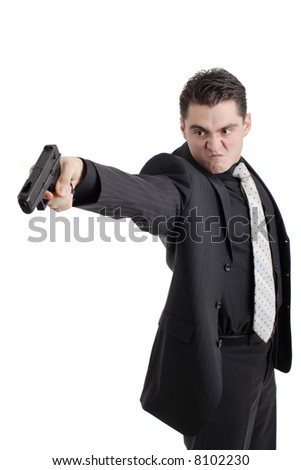 Angry person with a gun - stock photo