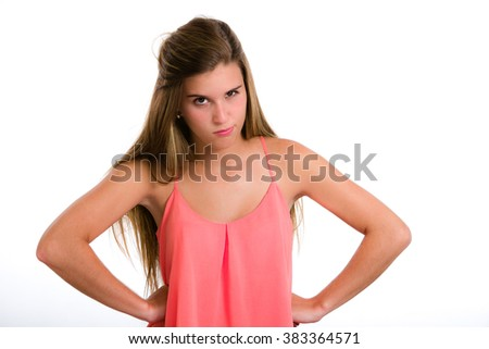 Angry, pissed off, furious. Hispanic young woman expression series.. Image isolated on white with clipping path. - stock photo