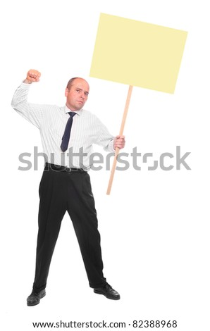 Angry protesting businessman with blank protest sign. - stock photo