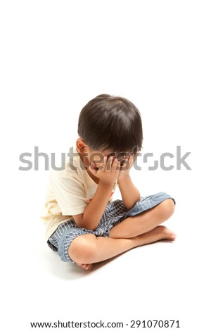 Angry sad child boy punishment isolated on white background - stock photo