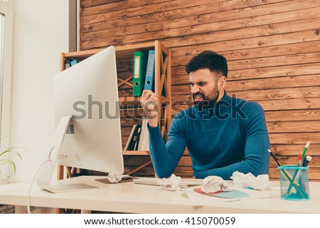 Angry sad man trying to find way to solve difficult task - stock photo