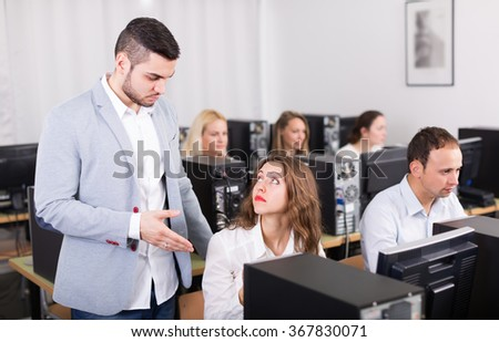 Angry sales department manager scolding upset office worker