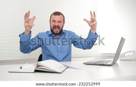 angry senior business man in the office - stock photo