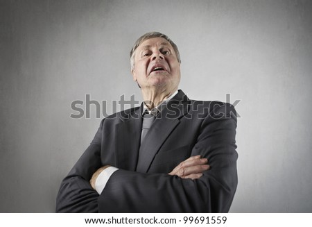 Angry senior businessman with disdained expression - stock photo