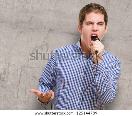 Angry Singer Singing against a grunge background - stock photo