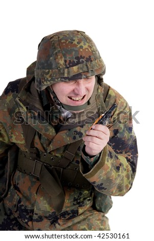 Angry soldier talking by walkie-talkie (isolated on white) - stock photo