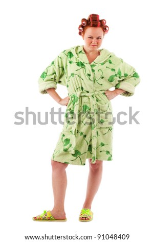 angry stereotypical houswife with hair rollers in green terry bathrobe - stock photo