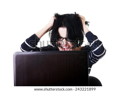 Angry student woman with a laptop. - stock photo