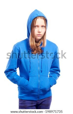 Angry teen girl in hood, studio shot - stock photo