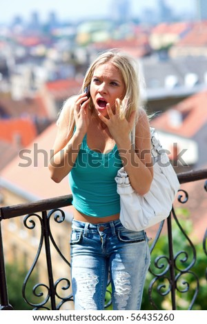 angry teen girl with mobile phone talking