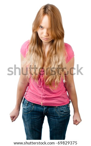 angry teenage girl standing isolated against white background and looking into the camera - stock photo