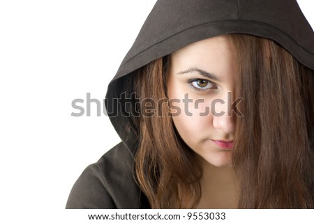 Angry Teenager with brown eyes wearing hood hiding face behind hair - stock photo