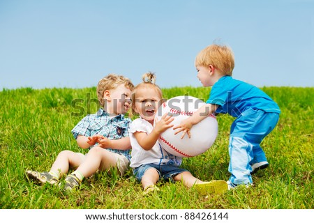 Angry toddlers fighting for the ball - stock photo