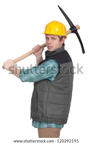 Angry tradesman with a pickaxe - stock photo